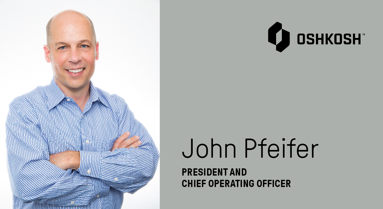 Photo of John Pfeifer in a blue button-up shirt with gray background, Oshkosh Corporation logo that says