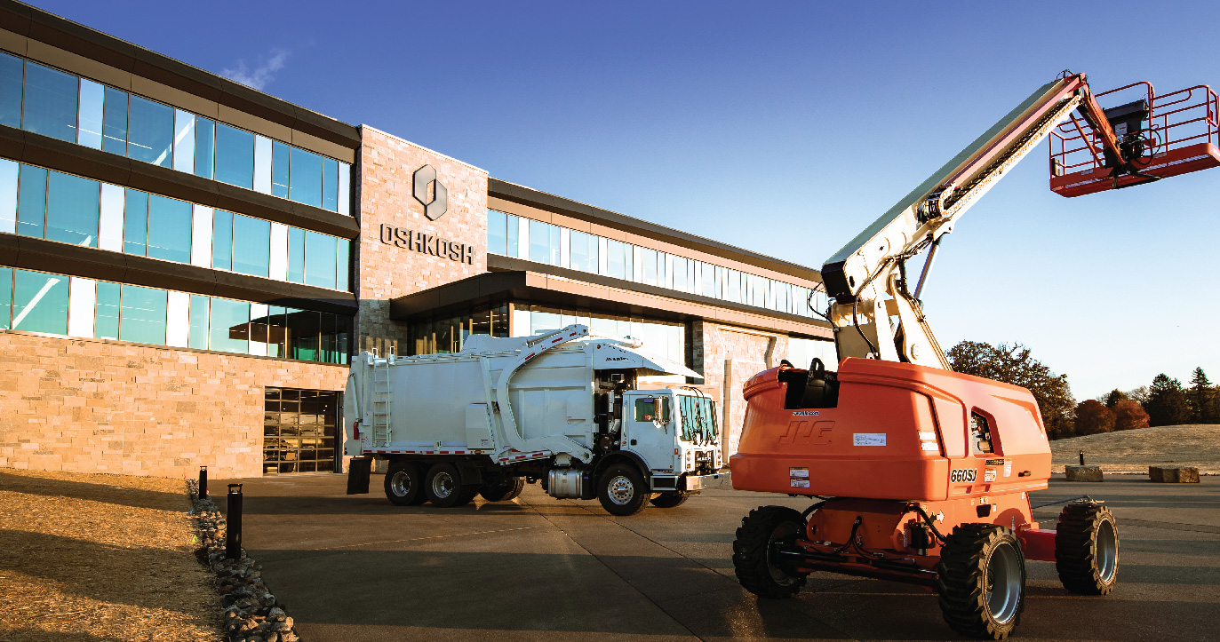 Global Headquarters of Oshkosh Corporation with refuse truck and JLG boom lift